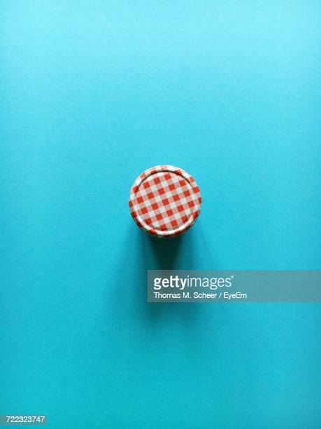 directly above shot of marmalade jar on blue background - jar stock pictures, royalty-free photos & images