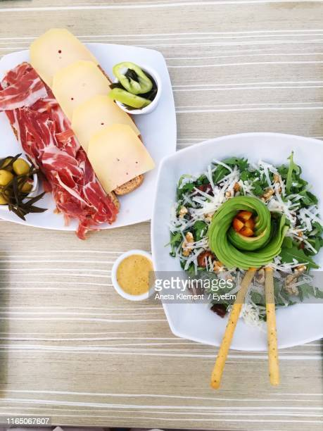 directly above shot of meal served in plates on table - aneta eyeem stock pictures, royalty-free photos & images