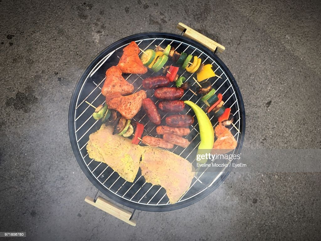 Directly Above Shot Of Meat And Vegetables On Barbecue Grill : Stock Photo