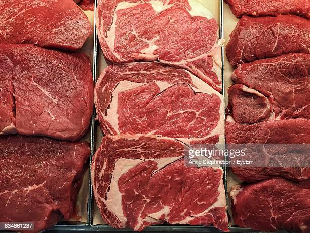 directly above shot of meats at butcher shop - butcher's shop stock pictures, royalty-free photos & images