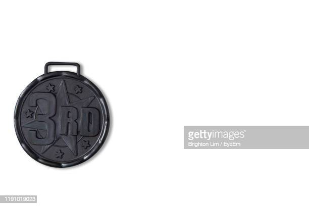directly above shot of medal against white background - third place stock pictures, royalty-free photos & images