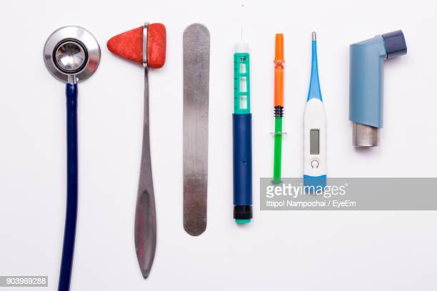 Directly Above Shot Of Medical Equipment Over White Background