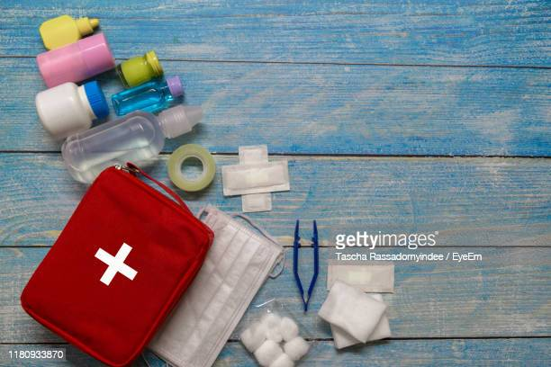 directly above shot of medical kit on table - first aid kit stock pictures, royalty-free photos & images