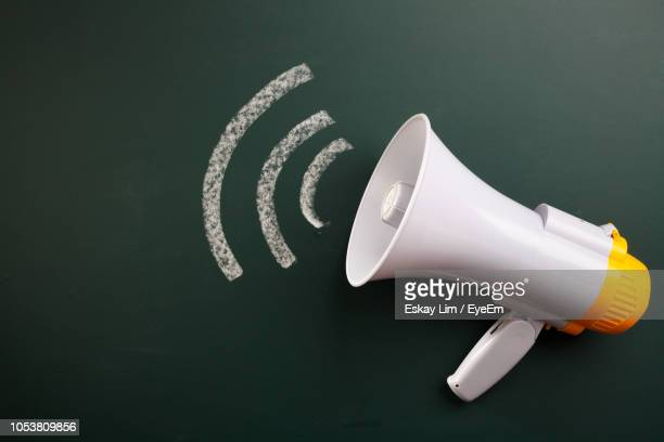 directly above shot of megaphone on black background - megaphone stock pictures, royalty-free photos & images