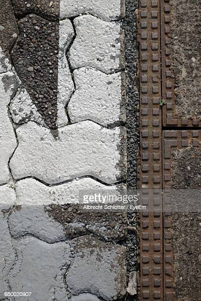 directly above shot of metal and paving stone - albrecht schlotter stock photos and pictures