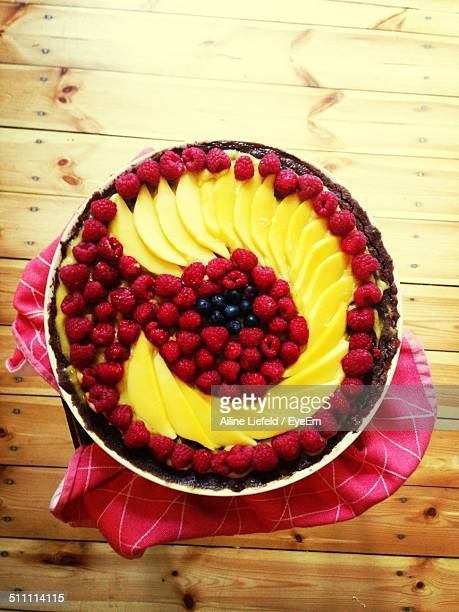 Directly above shot of mixed fruit cake on wooden table