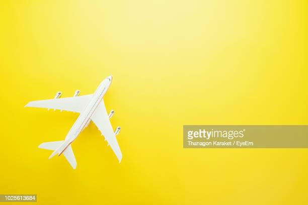 Directly Above Shot Of Model Airplane Over Yellow Background