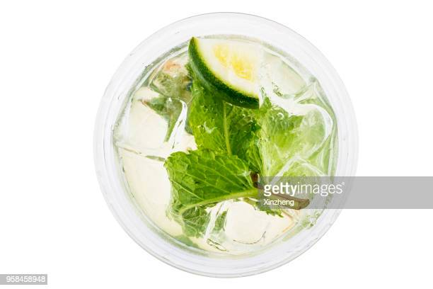directly above shot of mojito glass on white background - rafraîchissement photos et images de collection