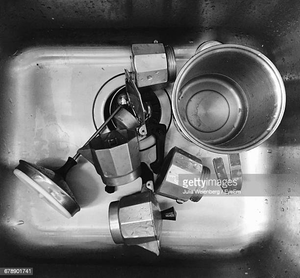 Directly Above Shot Of Moka Pot And Container In Sink At Kitchen