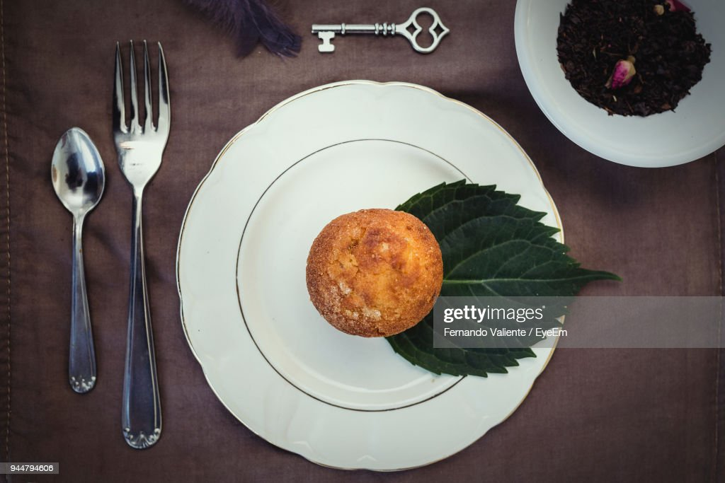 Directly Above Shot Of Muffin In Plate On Table : Stock Photo
