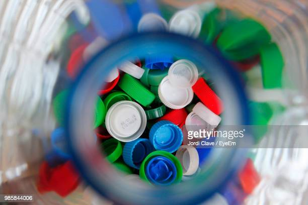 directly above shot of multi colored bottle caps - cap stock pictures, royalty-free photos & images