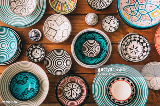 directly above shot of multi colored bowls on wooden table - moroccan culture stock photos and pictures