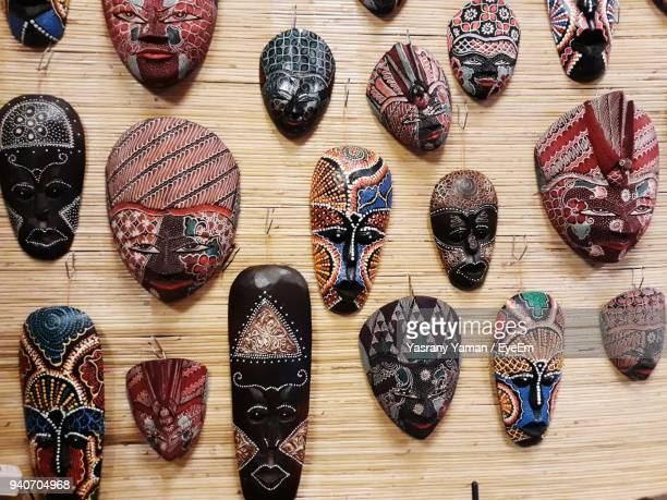 directly above shot of multi colored mask on table - eyeem collection stock photos and pictures