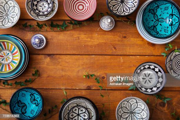 Directly above shot of multi colored pottery on wooden table