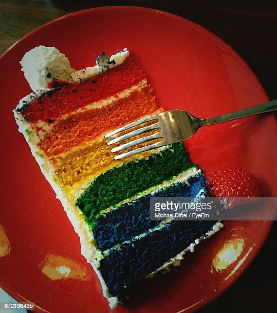 Directly Above Shot Of Multi Colored Sliced Cake On Table