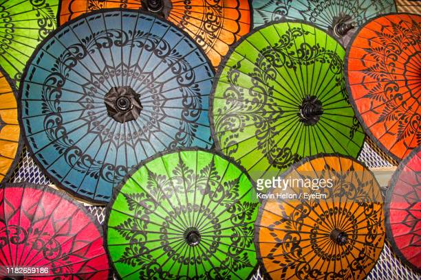 directly above shot of multi colored umbrella at market stall - yangon stock pictures, royalty-free photos & images