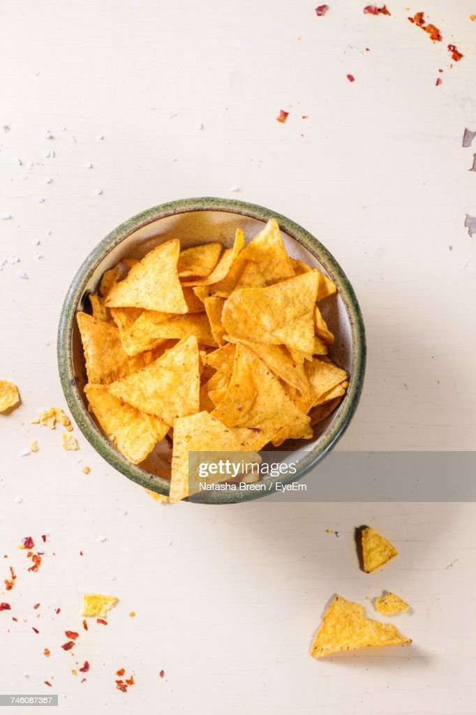 Directly Above Shot Of Nacho Chips In Bowl On Table : Stock Photo