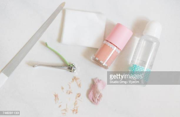Directly Above Shot Of Nail Grooming Equipment On White Table