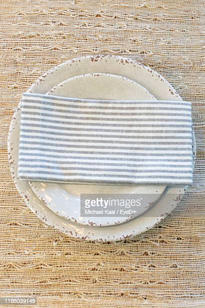 directly above shot of napkin on plate - kaal stock pictures, royalty-free photos & images