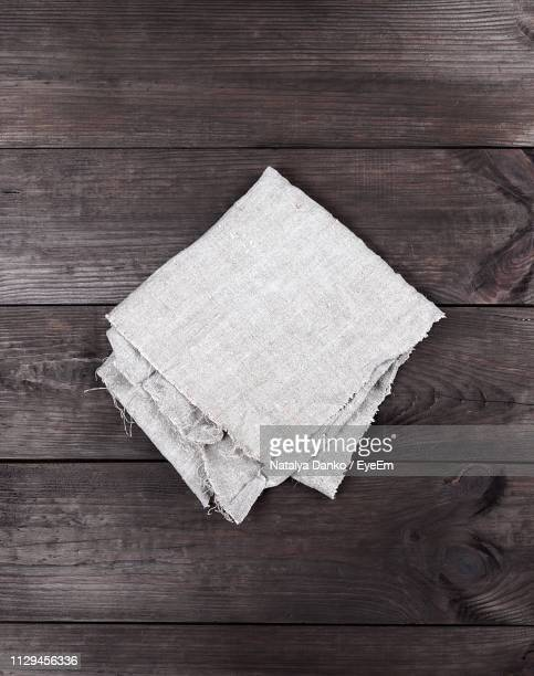 directly above shot of napkin on table - napkin stock pictures, royalty-free photos & images