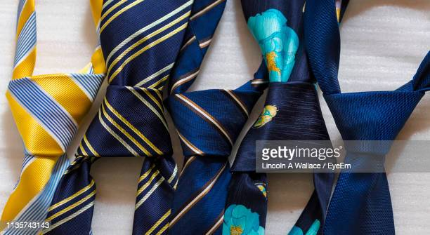 directly above shot of neckties on table - tie stock pictures, royalty-free photos & images