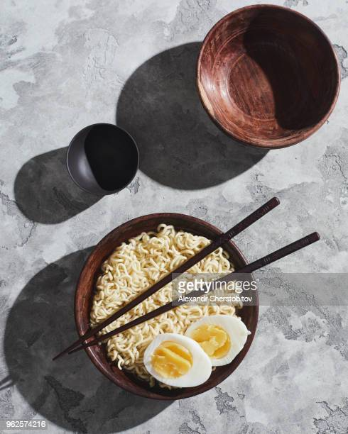 Directly above shot of noodles and egg served in bowl with chopsticks
