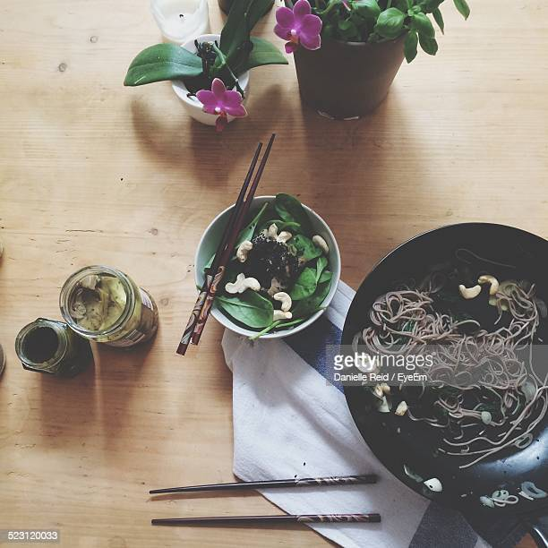 directly above shot of noodles served on table - danielle reid stock pictures, royalty-free photos & images
