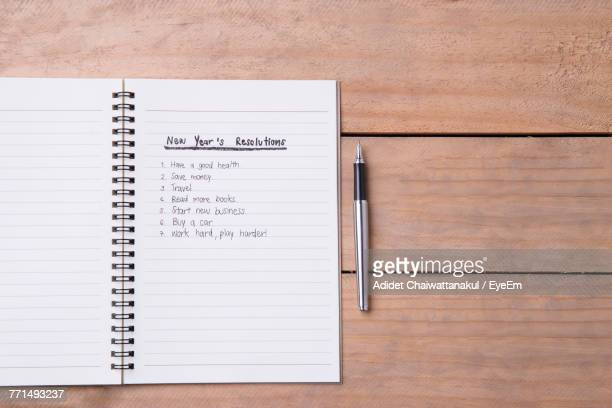 Directly Above Shot Of Note Pad With New Year Resolutions