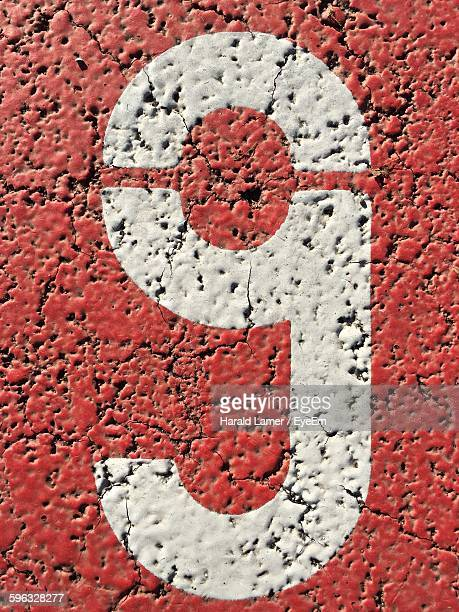 Directly Above Shot Of Number Nine Painted On Street