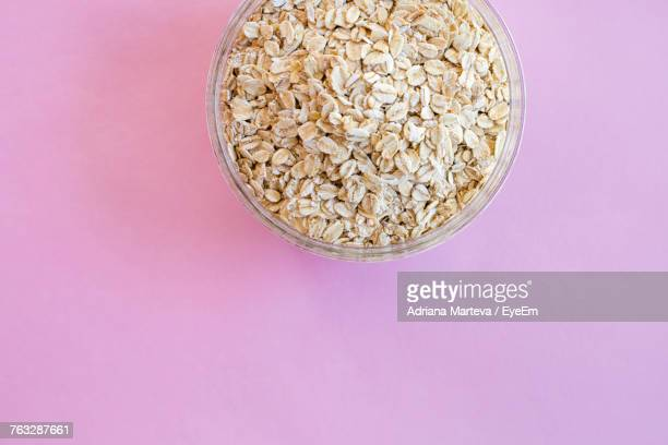 Directly Above Shot Of Oat Flakes In Bowl On Pink Background