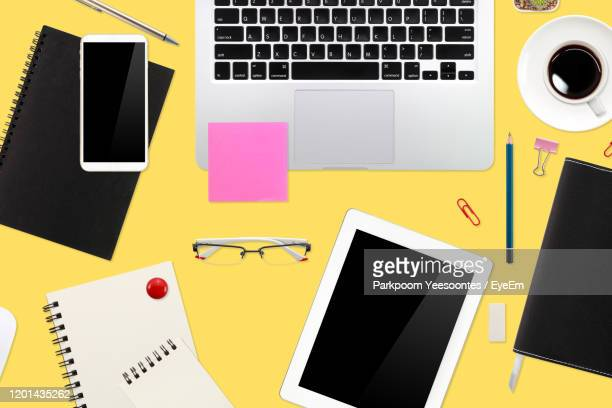 directly above shot of objects against yellow background - binder clip stock pictures, royalty-free photos & images