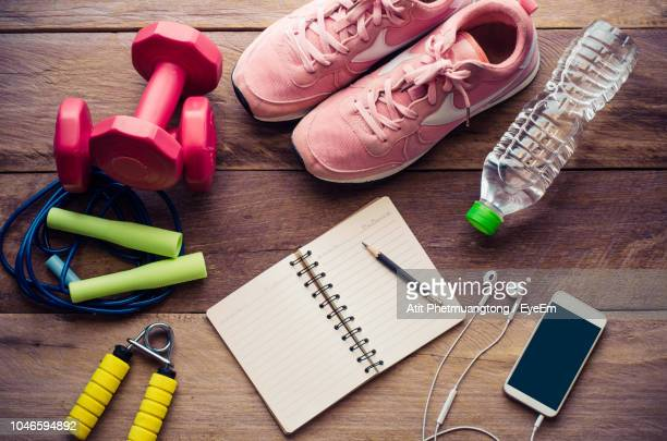 directly above shot of objects on table - exercise equipment stock pictures, royalty-free photos & images