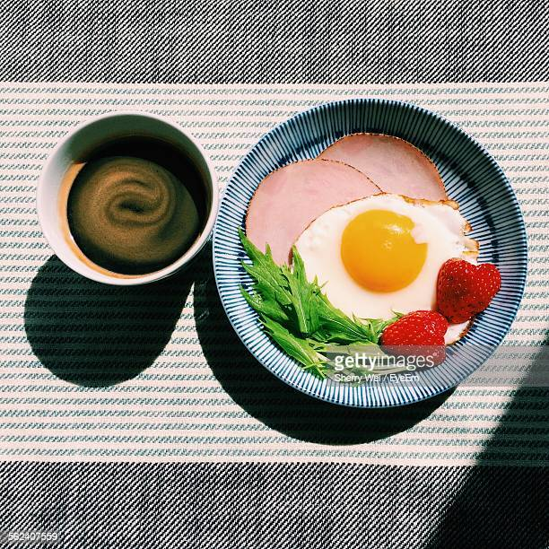 Directly Above Shot Of Omlete With Black Coffee On Table