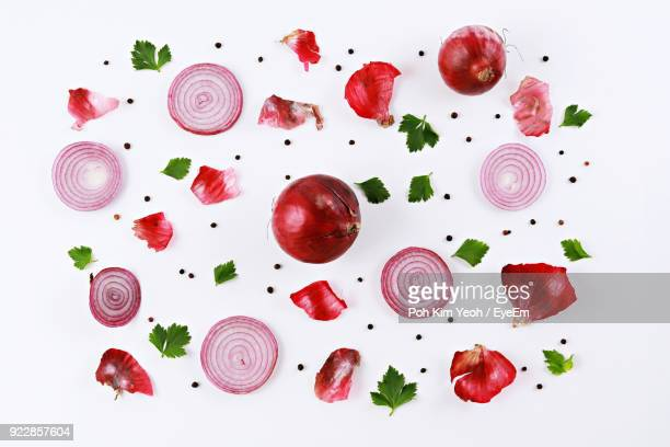 Directly Above Shot Of Onion With Herbs And Spices On White Background