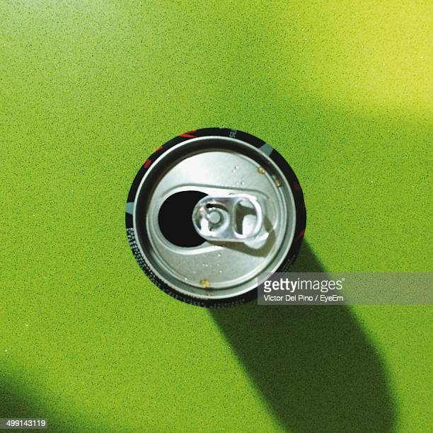 Directly above shot of open beverage can on green table