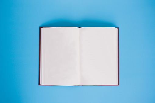 Directly Above Shot Of Open Book Against Blue Background - gettyimageskorea