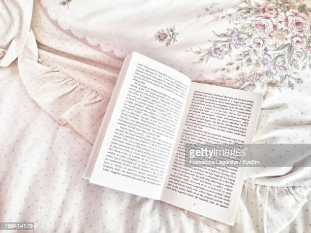 directly above shot of open book on bed - page stock pictures, royalty-free photos & images