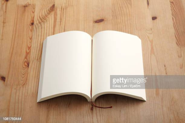 Directly Above Shot Of Open Book On Table