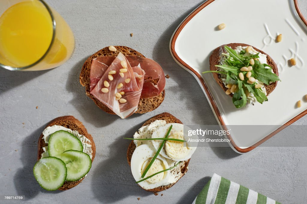 Directly above shot of open faced sandwiches with juice on table : Stock Photo