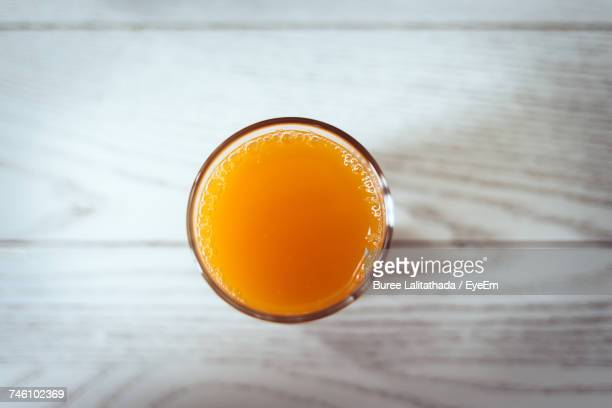 Directly Above Shot Of Orange Juice In Glass On Table