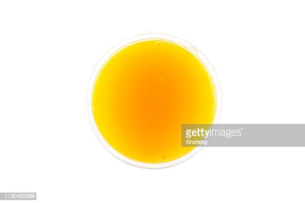 directly above shot of orange juice - orange juice stock pictures, royalty-free photos & images
