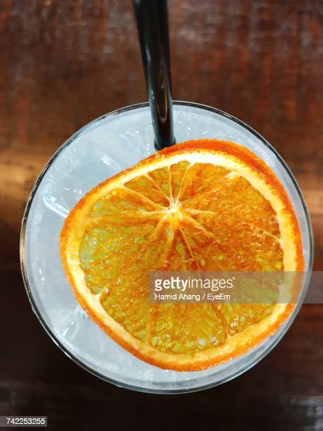 Directly Above Shot Of Orange Slice In Drink On Table