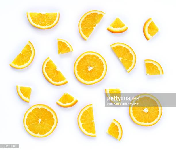 directly above shot of orange slices on white background - arancione foto e immagini stock