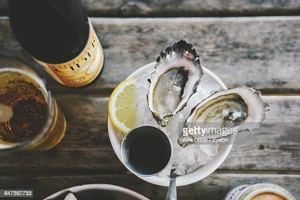 Directly Above Shot Of Oysters Served In Cup With Ice