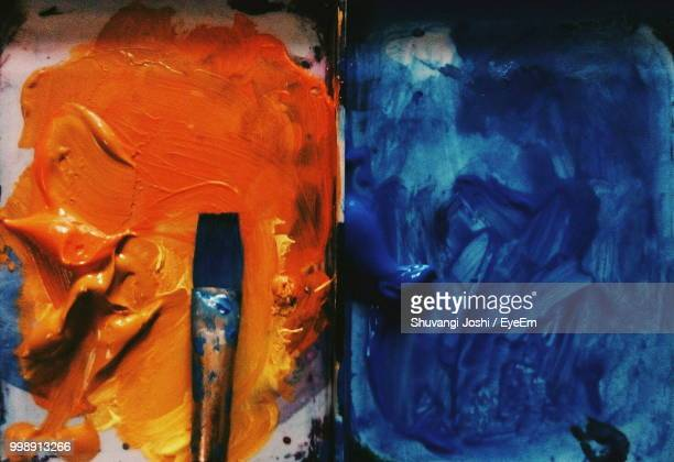 directly above shot of paint with brush on palette - artist's palette stock photos and pictures