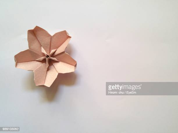 directly above shot of paper flower over white background - origami fotografías e imágenes de stock