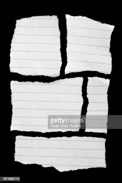 directly above shot of paper pieces on black background - lined paper stock pictures, royalty-free photos & images