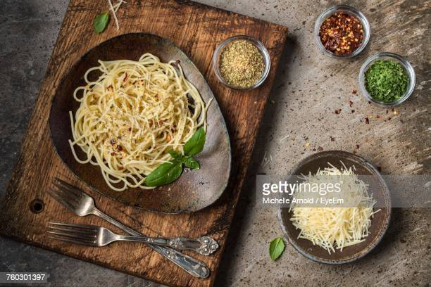 Directly Above Shot Of Pasta In Bowl On Cutting Board