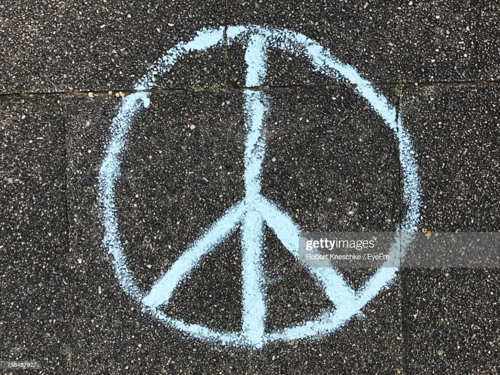 Directly Above Shot Of Peace Symbol On Road : Stock Photo