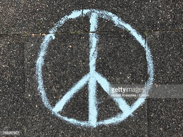 directly above shot of peace symbol on road - symbol stock pictures, royalty-free photos & images